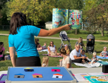 Photo of storytime in the park.